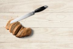 Bread with knife on wooden background. royalty free stock photos