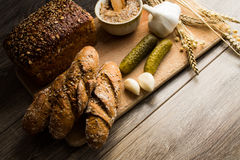 Bread lard and pickles on old wooden cutting board Royalty Free Stock Image