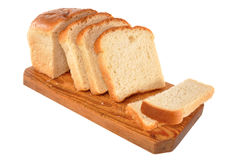 Bread lays on a board. Bread is cut on pieces and lays on a board Stock Images