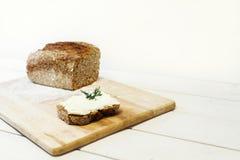 Bread lice with cream cheese Stock Photos
