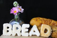 Bread life. The word bread written in sliced white bread with a vase of flowers Stock Image