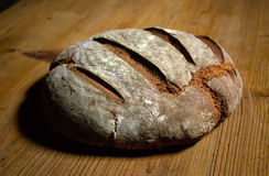 Bread loaf. Loaf of rye bread on wooden desk Royalty Free Stock Photo
