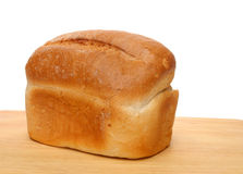Bread loaf. Loaf of white bread on wooden board stock image