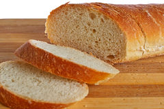 Bread. Loaf of bread on a board grooved Royalty Free Stock Photos