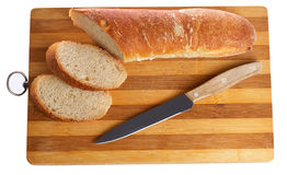 Bread. Loaf of bread on a board grooved Royalty Free Stock Images