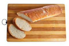 Bread. Loaf of bread on a board grooved Stock Photos