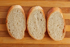 Bread. Loaf of bread on a board grooved Stock Image