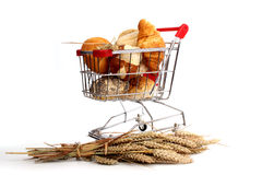 Bread loaf and buns in a shopping cart Royalty Free Stock Images