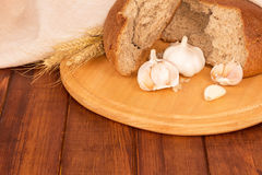 Bread loaf with garlic Stock Photography