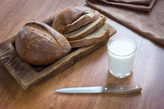 Bread loaf and milk in glass Stock Photos