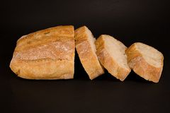 Bread loaf and slices Royalty Free Stock Photo