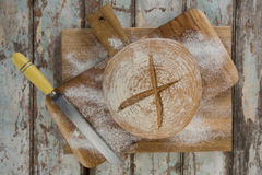 Bread loaf with wheat flour and knife Royalty Free Stock Photo