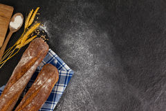 Bread loaf with wheat grains and flour Royalty Free Stock Photography