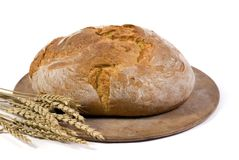 Bread loaf with wheat isolated 1. A crusted loaf of italian bread fresh from the oven with several stalks of wheat beside it Stock Photo