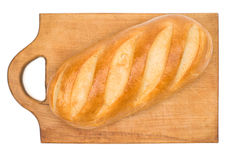 Bread loaf on a wooden chopping board isolated Royalty Free Stock Photography