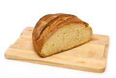 Bread loaf on wooden cutting board Stock Images
