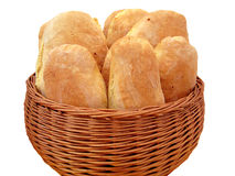 Bread loafs. Several loafs of Italian white bread in a brown basket isolated on white background Royalty Free Stock Photography