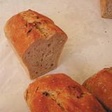Detai of a bread loaf. Bread loafs sold in a market stock image
