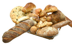 Bread Loaves. Large pile of bread loaves. Loaves have browned crusts and are of the hearty variety. Isolated on white background stock image