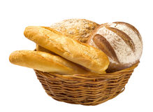 Bread loaves and baguettes in a basket. Bread loaves and baguettes in a wicker basket royalty free stock photo