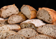 Bread Loaves and Slices. A variety of fresh baked loaves of bread, the loaves are cut in half and sliced stock images