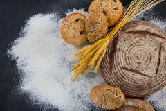 Bread loaves with wheat and flour Royalty Free Stock Images