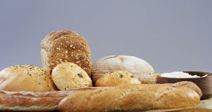 Bread loaves with wheat grains and flour. Close-up of bread loaves with wheat grains and flour stock video