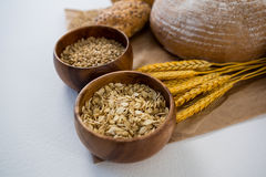Bread loaves with wheat grains and oats Stock Image