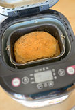 Bread machine and fresh bread at home Stock Photo