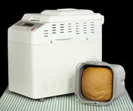 Bread machine making fresh bread at home. Stock Photos