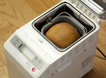 Bread machine making fresh bread at home. Royalty Free Stock Image