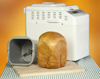 Bread machine making fresh bread at home. Stock Images