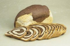 Bread marble rye loaf and slices Royalty Free Stock Images