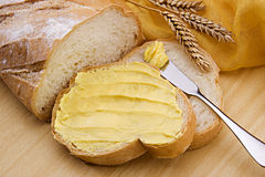 Bread With Margarine. Delicious bread with margarine on studio setting Stock Photo