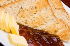Bread, marmalade and butter Royalty Free Stock Photography