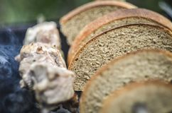 Bread and meat at BBQ royalty free stock image