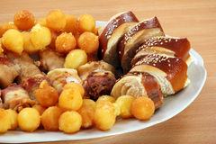 Bread meat and potatoes on plate Stock Images