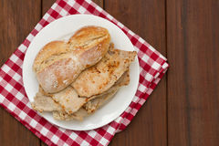 Bread with meat on white plate on brown Royalty Free Stock Images