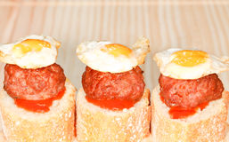 Bread with Meatballs and Quail Eggs. Three appetizer of bread, meatballs and quail eggs. On wooden table Royalty Free Stock Photo