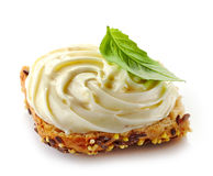 Bread with melted cream cheese. On a white background Royalty Free Stock Photo