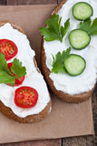 Bread with mild cream cheese, tomato and cucumber Royalty Free Stock Photo