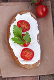 Bread with mild cream cheese, tomato  Stock Images