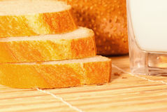 Bread with milk. Bread arranged on table close up Royalty Free Stock Images