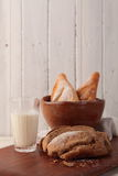 Bread and milk. Whole wheat bread, baguette and milk are on the table Stock Photos