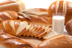Bread and milk. White freash bread with glass of fresh milk Royalty Free Stock Images