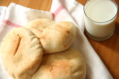 Bread and milk. White bread and a glass of milk Royalty Free Stock Photo
