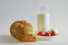 Bread and milk breakfast eggs tomatoes Royalty Free Stock Photo