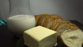 Bread, milk and butter on wooden table, close HD. Bread, milk and butter on wooden table, close stock video