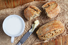 Bread and milk. Close up of healthy wholegrain crispy bread and cup of milk Stock Images
