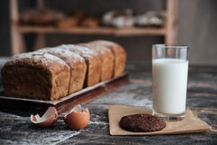 Bread with milk and cookie near eggs Royalty Free Stock Photos